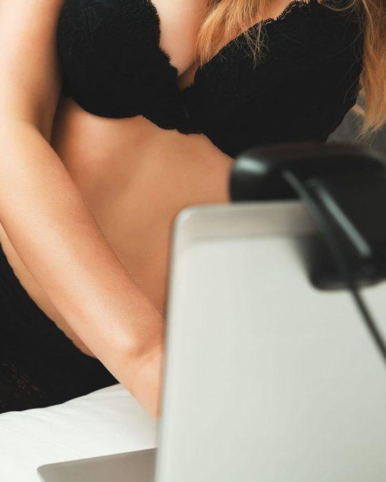 2D9DX9T Seductive woman working as webcam model.